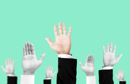 hand raising: Hand raising upward with unique colored one, on pastel vintage tone background , abstract concept and ideas Stock Photo
