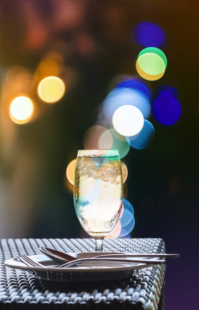 lighting background: Glass of cold water with nightlife Bokeh lighting background