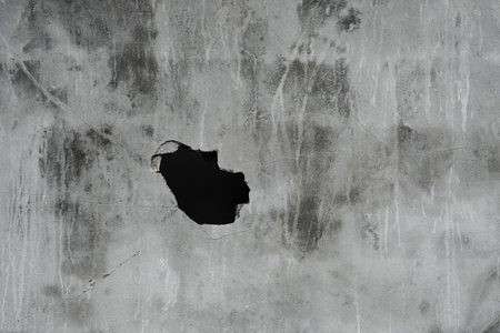 orifice: Cracked concrete texture with hole