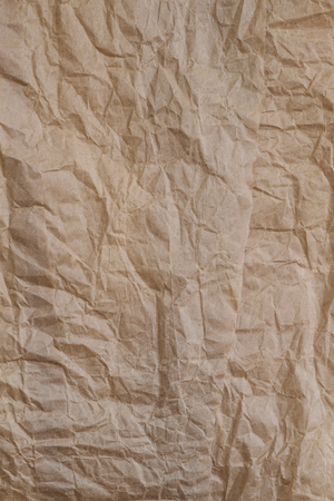 lacerate: Crumpled brown paper texture. crumpled paper. crumpled texture