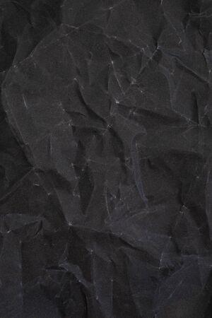 lacerate: Crumpled black sandpaper texture. crumpled paper. crumpled texture