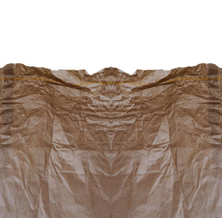 frowzy: Crumpled brown paper bag with white copy space