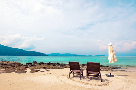 Holidays on the beach, beach chairs on the beach in the morning