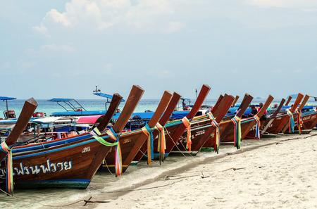 plentifully: Traveler boats parked arrange on Lipe island, Thailand