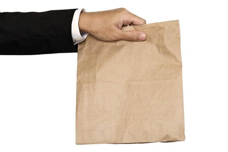 brown paper bag: Businessman hand holding(Sharing,giving) brown paper bag lunch, isolated on white background