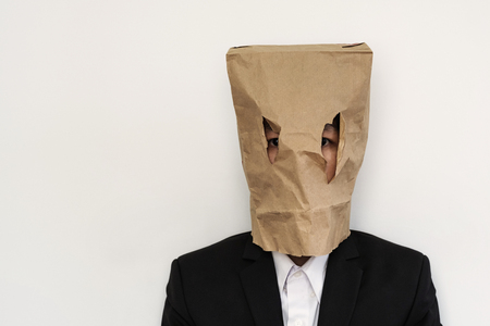 humiliation: Businessman with brown paper bag on head