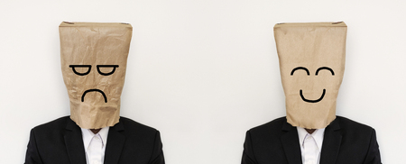 unhappy man: Businessman with crumpled paper bag with anger bored face, and smooth paper bag with smiling face