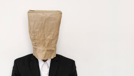 bureaucrat: Businessman wearing brown paper bag Stock Photo