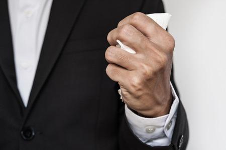 Businessman squeeze paper, hand close up