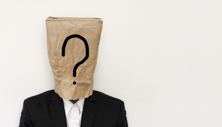 bureaucrat: Businessman with brown paper bag on head, with question mark symbol with copy space, on white background