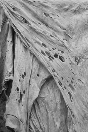 Old dirty torn rag, rag texture, vertical