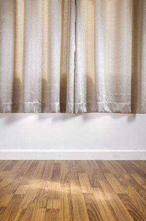 laminated: laminated wood floor with white wall, with curtain