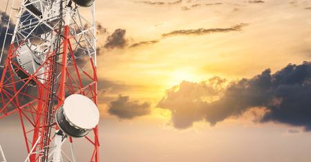 Telecommunications tower and satellite dish telecom network at sunset