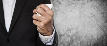 Business employee squeeze crumpled paper in hand, on concrete texture background with copy space Stock Photo