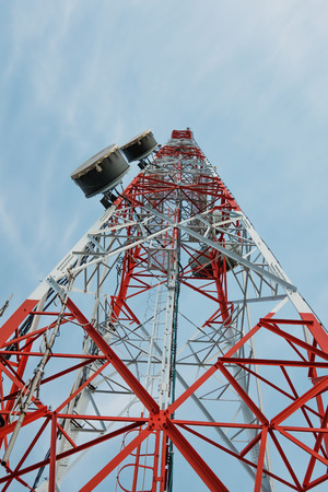 telecoms: Satellite dish telecoms on telecommunications tower on blue clear sky Stock Photo