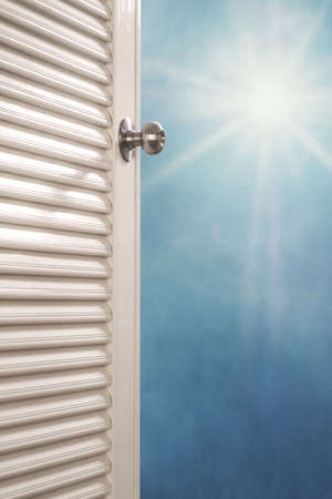 dreamy: Door opening with blue sky and shiny sunshine, dreamy concepts