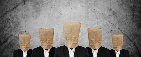 brown paper bag: Group of businessman in suit with brown paper bag on head, on concrete texture Stock Photo