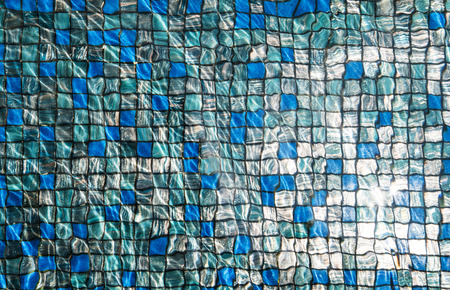 mosaic tiles: Blue mosaic tiles under swimming pool with rippled water and reflection of bright sunlight