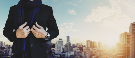 Businessman in casual suit with cityscape view in sunrise background