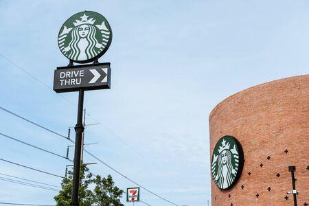 thru: BANGKOK, THAILAND - 2 SEP - Starbucks drive thru sign at one of the fastest growing industrial Bangkok, Thailand on September 2, 2016