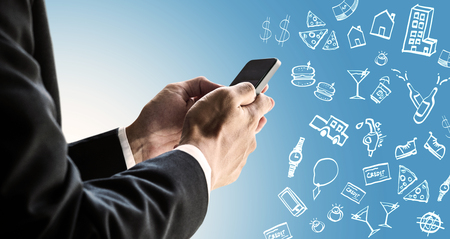 paying bills online: Businessman using smartphone with expense doodle images, paying bills online by smartphone concept