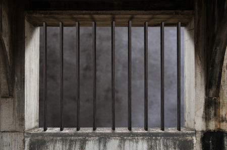 barred: Interior of a prison cell with light shining through a barred window