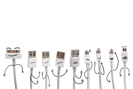 moods: Various USB cable ports with funny cartoon character face, isolated on white background Stock Photo