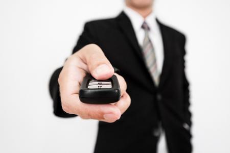 keyless: Close-up businessman hand using car wireless remote key, selective soft focus, shallow depth of field