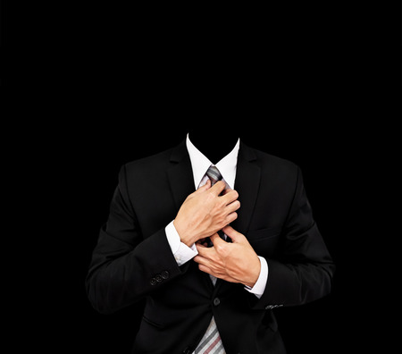 Headless businessman in black suit, with copy space