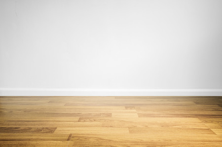 white wood floor: Laminated wood floor with white wall Stock Photo
