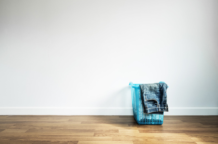launder: Laundry Basket on Wooden Floor and White Wall