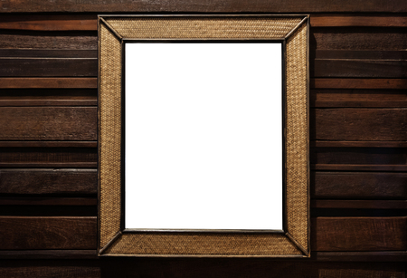 wall mirror: Rattan wicker wooden picture frame. rattan wicker wooden wall mirror decorate, on hardwood wall Stock Photo