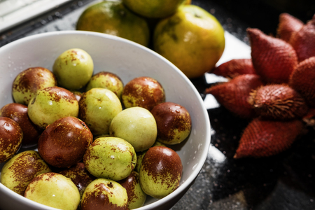 Tropical fruits, fresh Jujube in crockery, with Zalacca and orange
