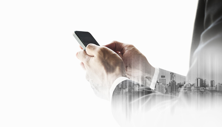 Businessman using smartphone with double exposure city, business communication technology concepts, isolated on white background