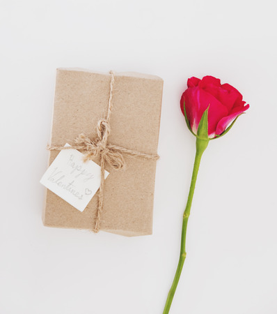 red gift box: Gift box with roses flowers, for valentines day gift, on white table