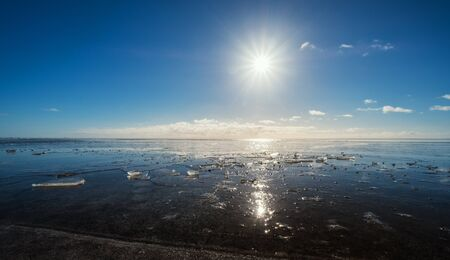 Frozen lake with the sun and flare effects, Beautiful landscape in winter
