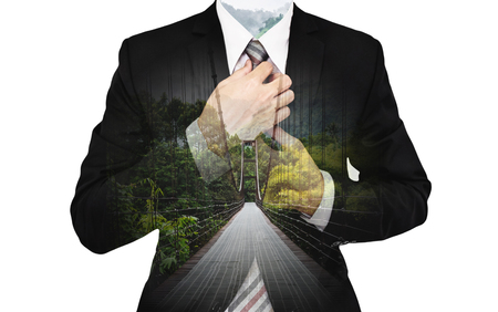 Double Exposure Businessman with suspension bridge and green forest Stock Photo