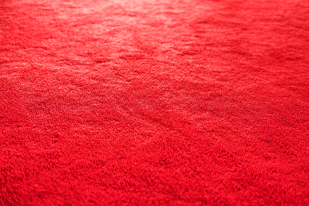 rug texture: Red carpet texture with bright light, selective focus