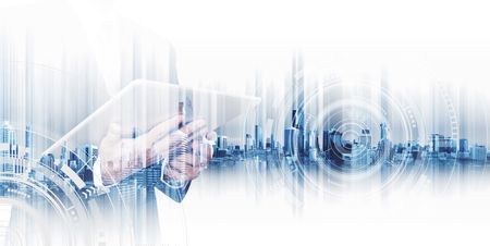 Double exposure businessman working on digital tablet, concepts of business technology network Foto de archivo