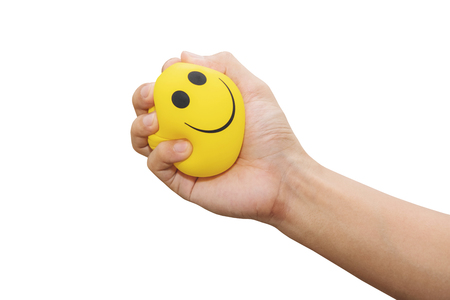 Hand squeeze yellow stress ball, isolated on white background, anger management, positive thinking concepts Imagens - 79459347