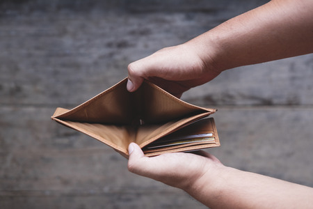 Hand opening empty wallet Banco de Imagens - 80130230