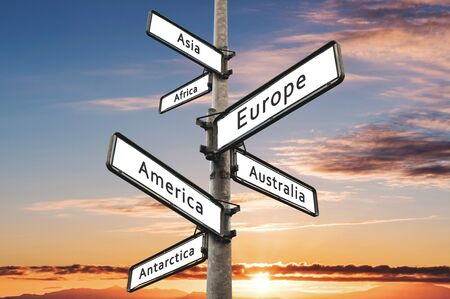 Continents on road direction signpost, with sunset sky background Stock Photo