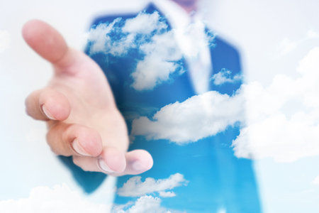 environmentalist: Businessman stretch out hand, with double exposure blue sky and white cloud background