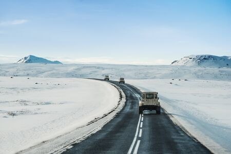 winter road: Winter road landscape, with a cars driving on highway in Iceland