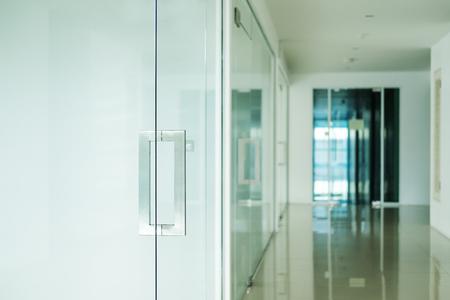 Modern office interior, selective focus on doorknob