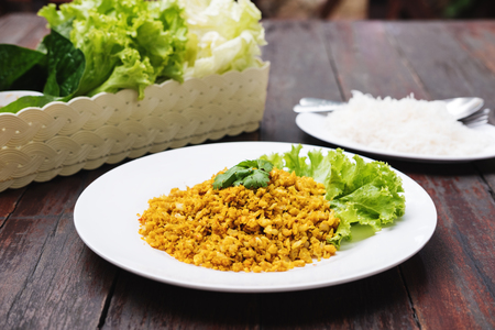 Traditional Thai Food, Fish fried with curcuma herb serves with fresh vegetable, thin rice noodle and seafood spicy food Stock Photo