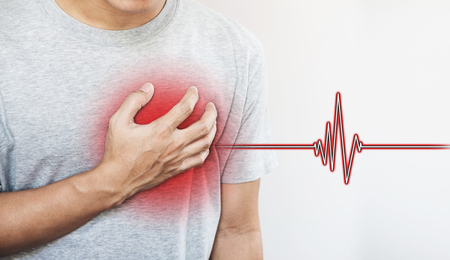 a man touching his heart, with heart pulse sign. Heart attack, and others heart disease concepts