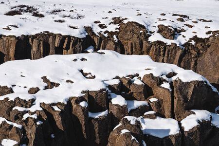 Snow covered on stones in winter