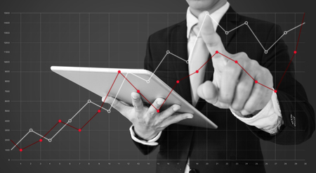 Businessman touching raising graph on screen. Business growth, investment and finance concept