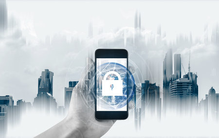 Mobile device security and internet connection . Hand using mobile smart phone and lock icon.